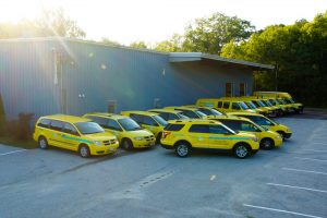 Yellow ServiceMaster vans parked outside a warehouse
