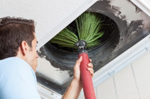 Cleaning an air duct using a duct brush